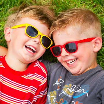 two boys with sunglasses on